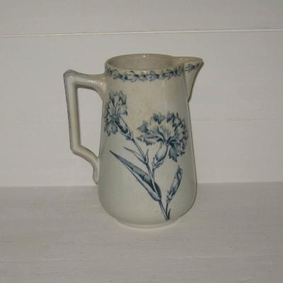 Ancien pot à lait en faïence de Lunéville modèle oeillet