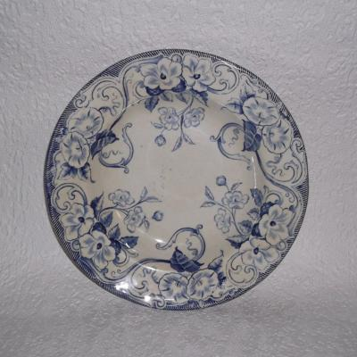 Assiette creuse ancienne en faïence de Creil et Montereau du service Flora décor liseron