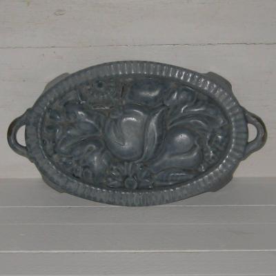 Ancien dessous de plat art déco en fonte émaillée bleue