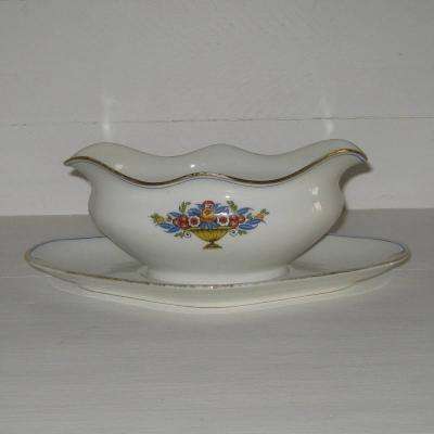 Ancienne saucière en porcelaine de Limoges décor coupe fleurie