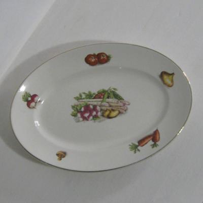 Ancien grand plat ovale en faïence décor légumes Digoin Sarreguemines