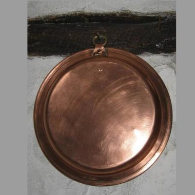 Plat en cuivre de forme ronde intérieur étamé