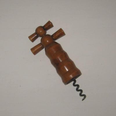 Ancien tire-bouchon cloche en bois à mécanisme
